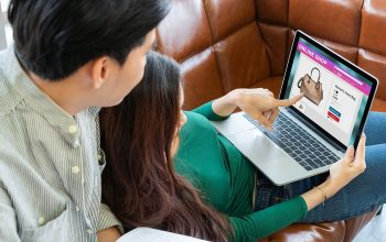 Young Couple Use Credit Card For Online Shopping On Internet Web