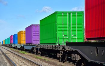 Cargo Containers Transportation On Freight Train By Railway. Int