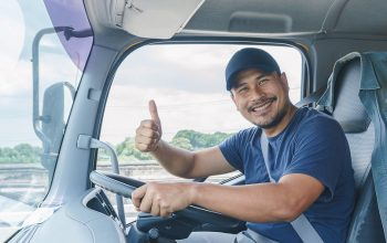 Smile Confidence Young Man Professional Truck Driver In Business