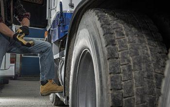 Caucasian Truck Driver Or Trucker In His 40s Preparing His Semi