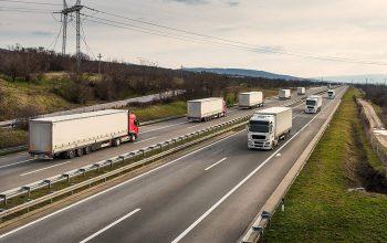 Convoys Or Caravans Of Transportation Trucks Passing On A Highwa